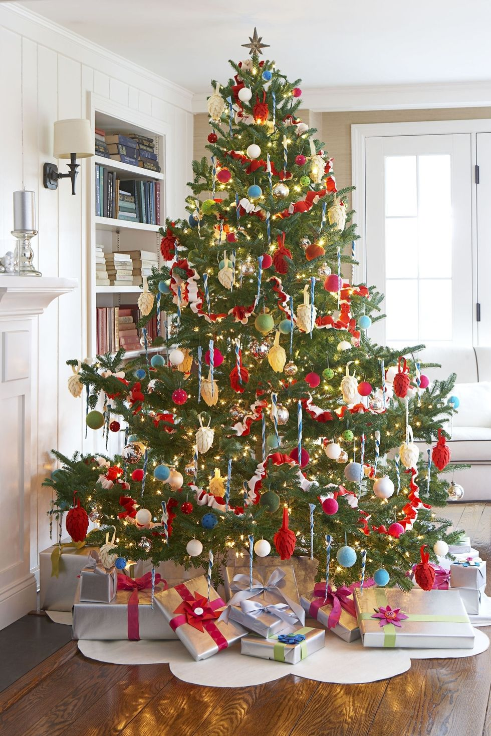 Good Housekeeping - Michael Partenio - red and gold christmas tree decorating ideas - christmas tree ideas - elegant christmas trees - colorful christmas tree decorations