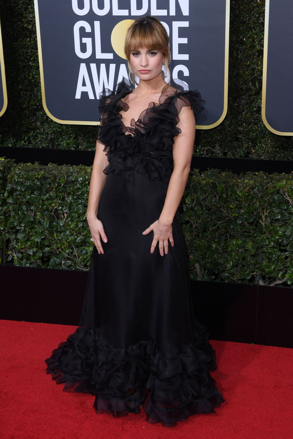 Golden Globes Red Carpet 2018 - Lily James in Valentino with Harry Winston jewelry - Photo credit Rex/Shutterstock - women empowerment - black dresses golden globes 2018 - times up