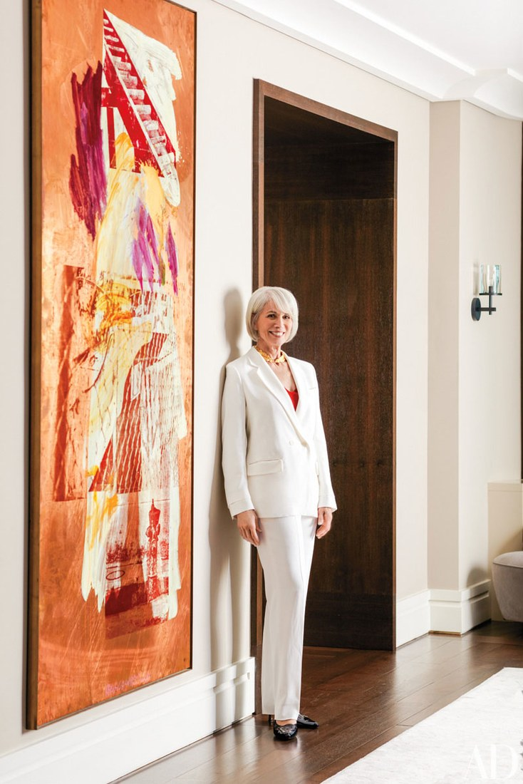 Women Empowerment - Holly Hunt's Chicago Apartment - holly hunt art collection - holly hunt showroom - holly hunt furniture - holly hunts home - Photo via Architectural Digest - Robert Rauschenberg painting