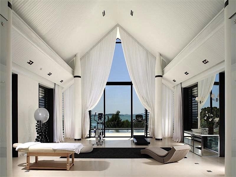 luxury seaside homes - luxury home gym - niche real estate - beachfront homes - luxury coastal homes - beachfront gyms