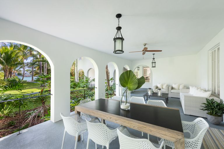 Al Capone's Former Mansion Miami - Image via Elle Decor (EWM Realty International) - luxury seaside homes - luxury coastal homes - beachfront homes - beachfront terraces