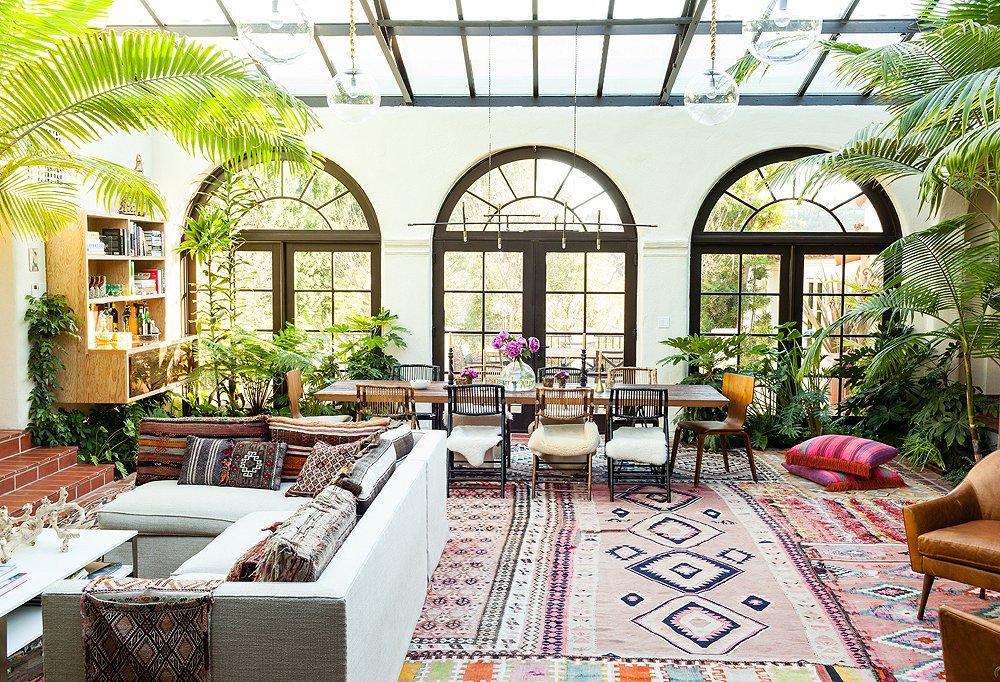 Layering rugs - Katie Tarses Home. Photo by Nicole LaMotte via One Kings Lane - living room design ideas - layering patterned rugs
