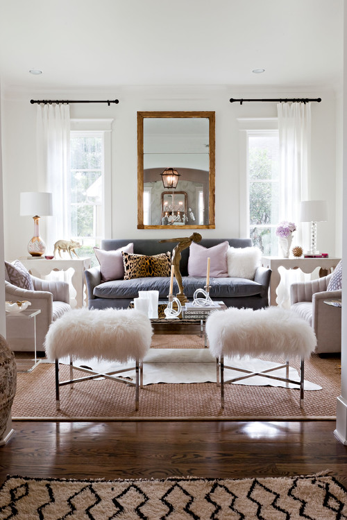 Layering Rugs - Interior Design by Sally Wheat Interiors - living room design ideas - layering cowhide rugs - cowhide rug over carpet