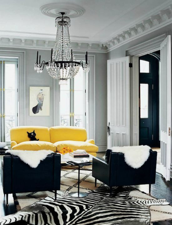 Layering rugs - Photo by Domino Media Group - living room design ideas - zebra print rugs - layering with Moroccan rugs