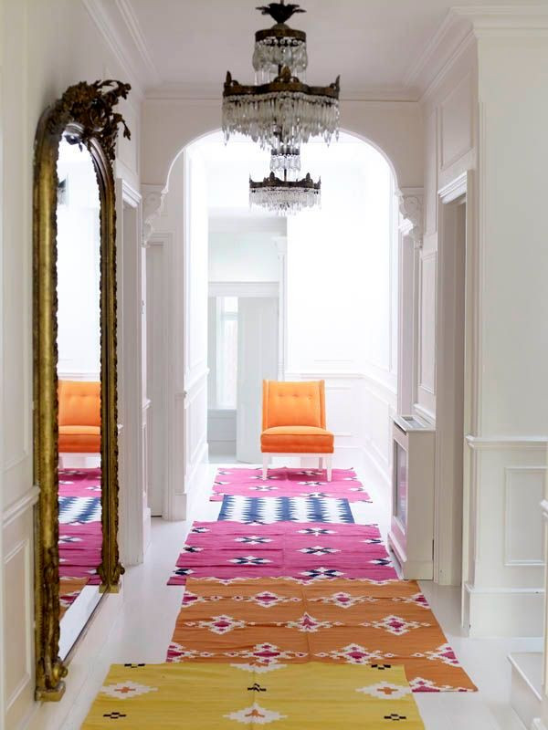 Layering rugs - Photo by Sarah Kaye - hallway design ideas - colorful rug ideas - hallway decorating ideas