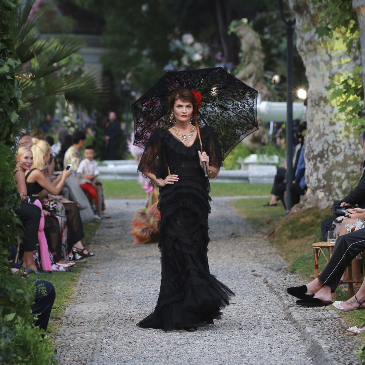 Helena Christensen walks for the Dolce and Gabbana Alta Moda Fashion Show at Lake Como, July 2018 - via @dolcegabbana - dolce & gabbana haute couture - couture black parasol