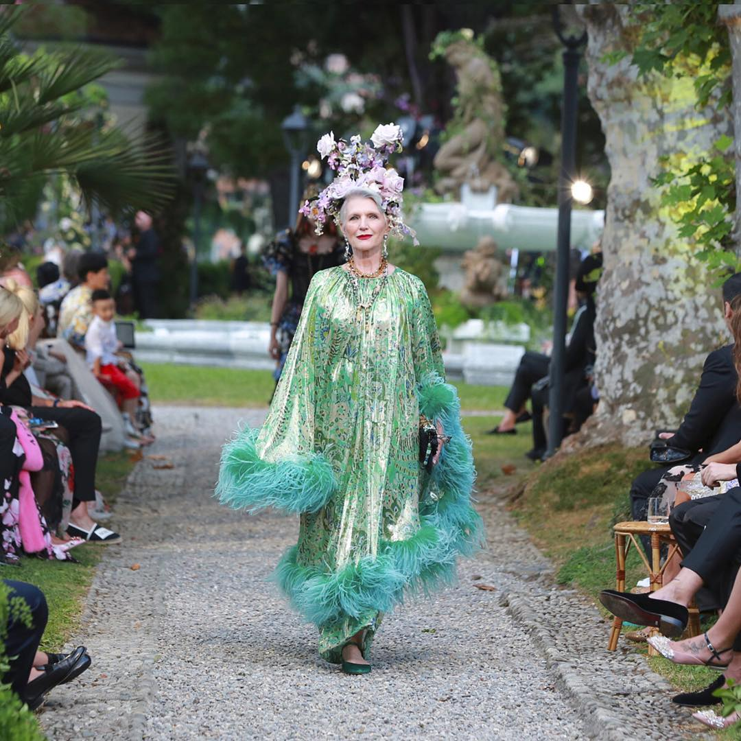 Maye Musk walks for the Dolce and Gabbana Alta Moda Fashion Show at Lake Como, July 2018 - via @dolcegabbana