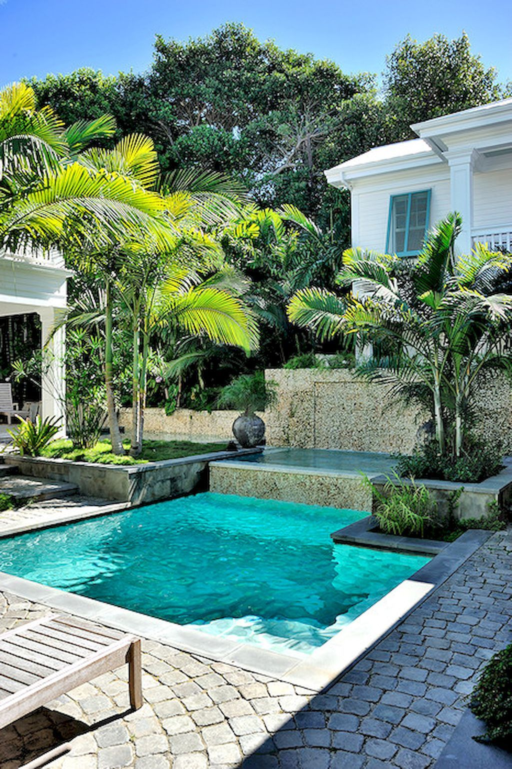Luxurious Backyard Retreats - luxury outdoor living spaces - pool design ideas - luxurious pools