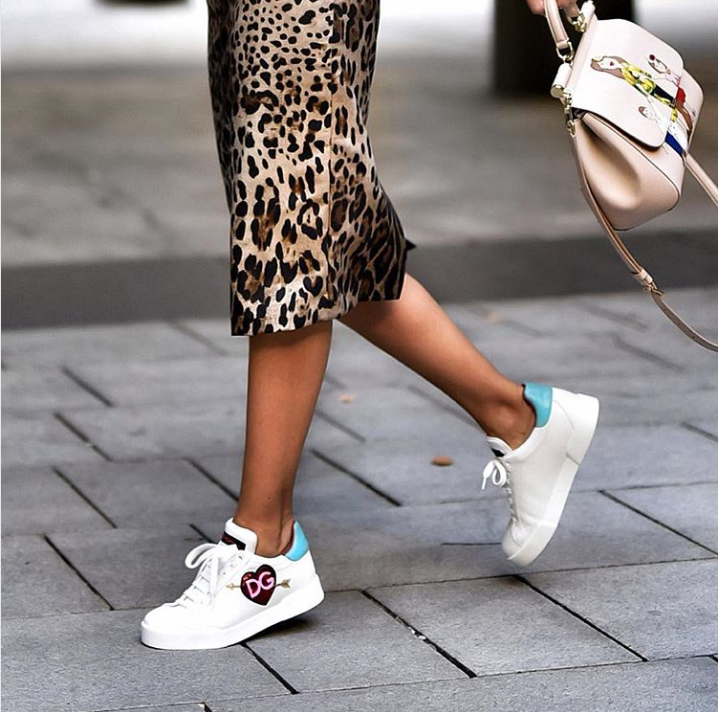 how to dress to impress wjhen traveling the world - Dolce Gabbana Sneakers - Instagram @shortstoriesandskirts - white sneakers - animal print skirts - street wear - travel outfit ideas