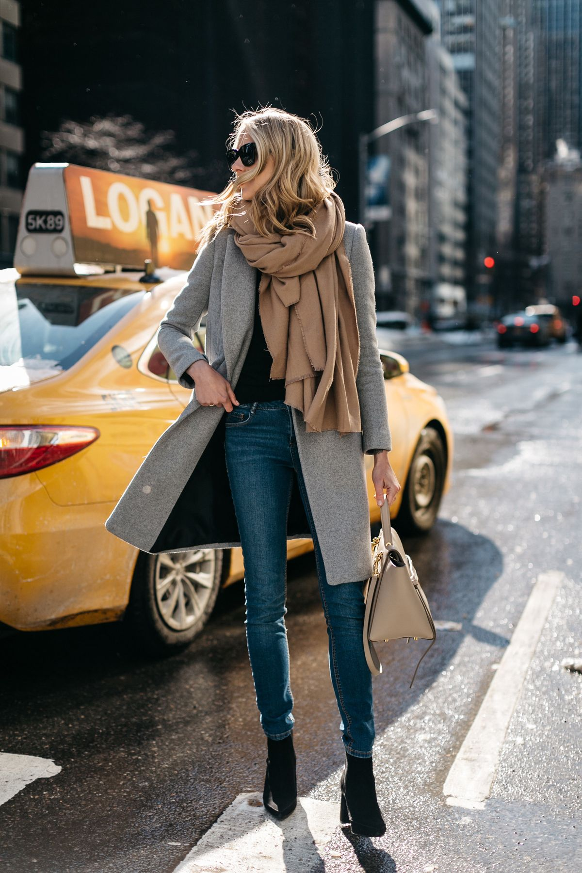 How to Dress to Impress When Traveling the World - Fashion Jackson - blanket scarves - blanket scarf - travel outfit ideas - fashionable travel tips