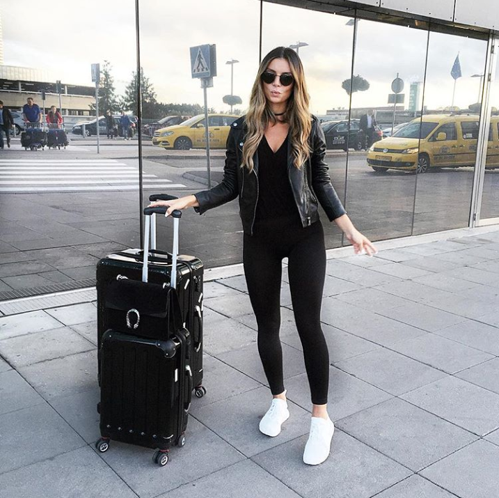 How to Dress to Impress When Traveling the World - Instagram @fashionablefit - best travel luggage - travel outfit ideas