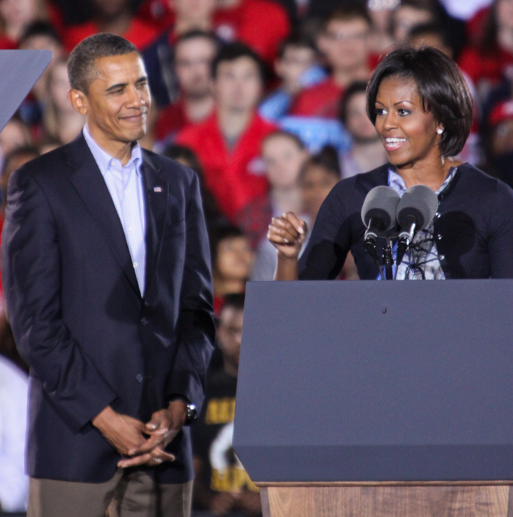 The Woman Behind the Man - Barak Obama and Michelle Obama at OSU Rally Columbus Ohio 2010 - Photo by Adam Schweigert via Flickr - the man behind the woman