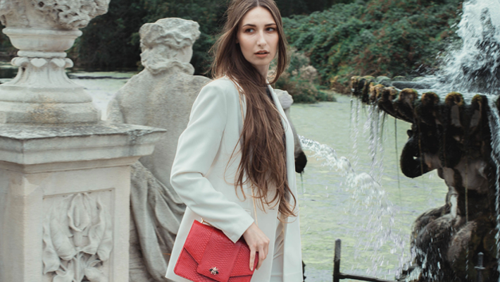 Victoria Chi walks with the iconic Empress handbag in red python leather £1,500, 24x17x6 cm. www.vicacustom.com. Picture-Olegas Daghool. Styling-Leisel Vella. Make-up-Isreal Cozas Garcias - vica custom - custom leather bags - custom leather handbags - custom leather purses - bespoke handbags - bespoke purses - exotic skin purses - exotic skin handbags - exotic leather handbags - exotic leather bags - exotic leathers - python handbags - stingray handbags - crocodile handbags