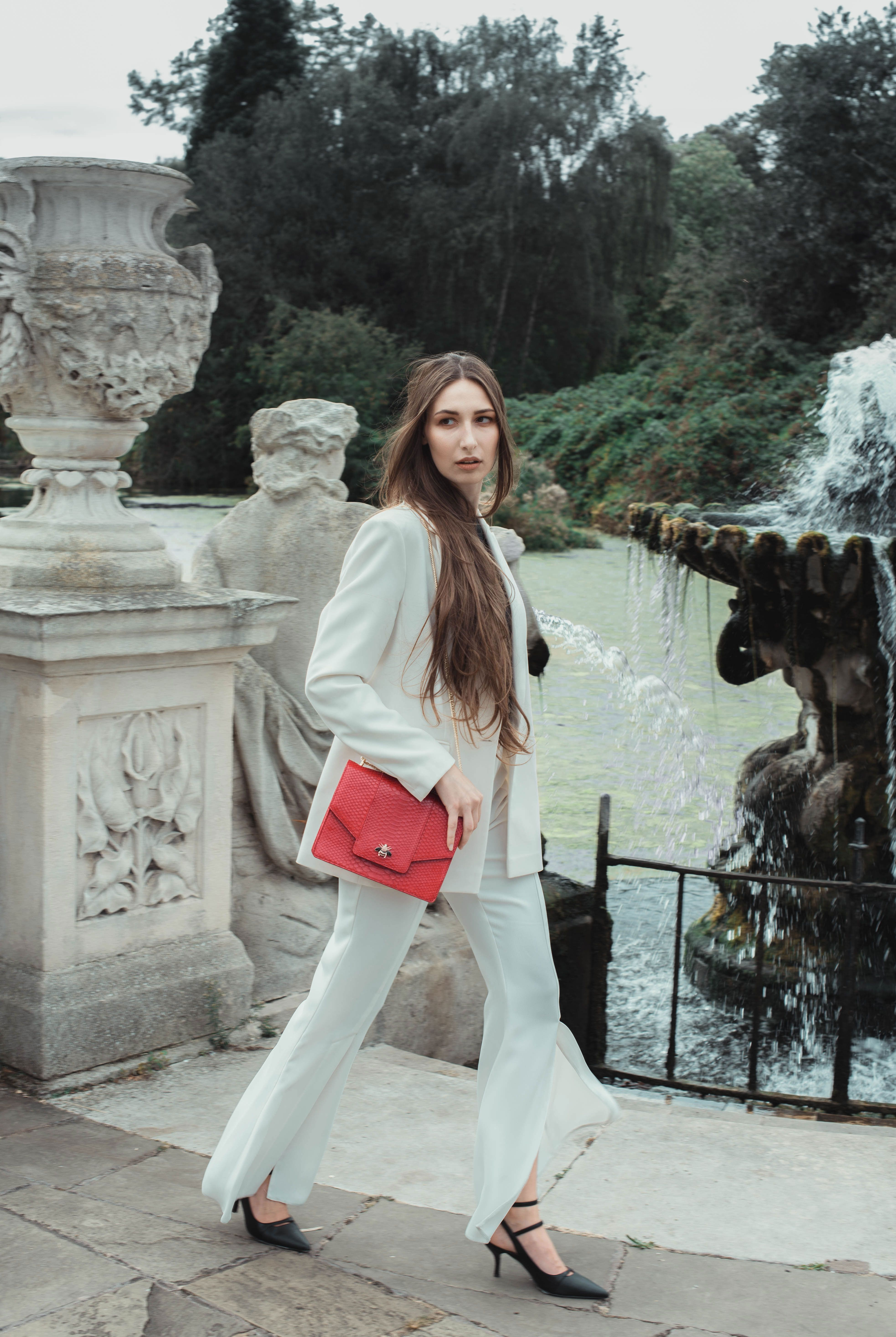 Victoria Chi walks with the iconic Empress handbag in red python leather £1,500, 24x17x6 cm. www.vicacustom.com. Picture-Olegas Daghool. Styling-Leisel Vella. M