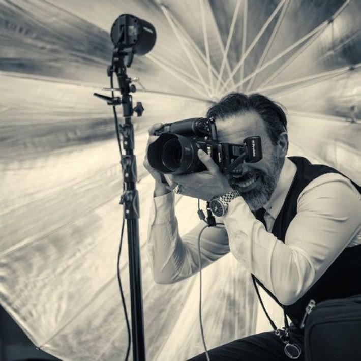 Marco Joe Fazio taking a photograph, a master of visual storytelling