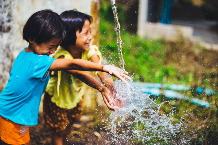 International Day of the Girl Child: Celebrating Girl Power & The Launch of the Obama Foundation's Global Girls Alliance - Photo by Abigail Keenan on Unsplash - Young girls playing in water