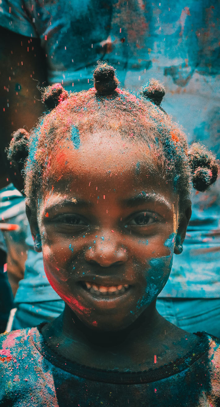 International Day of the Girl Child: Celebrating Girl Power & The Launch of the Obama Foundation's Global Girls Alliance - Photo by Deva Darshan via Unsplash - Young African Girl covered in blue paint