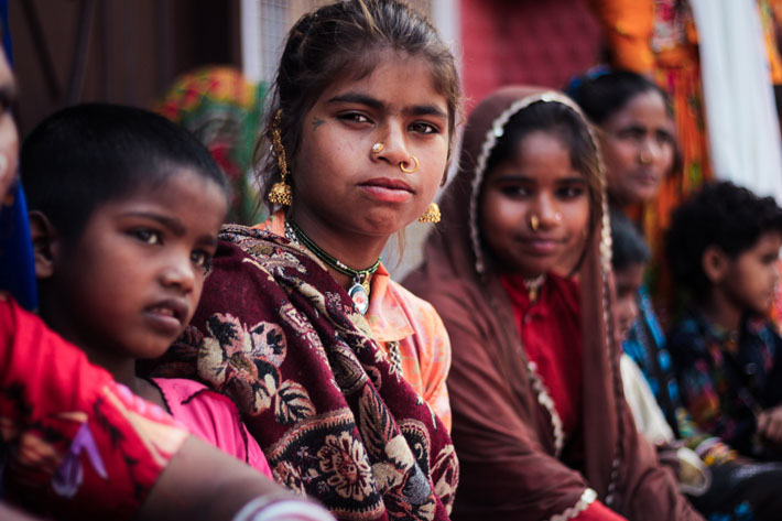 International Day of the Girl Child: Celebrating Girl Power & The Launch of the Obama Foundation's Global Girls Alliance - Photo by Sharon Christina Rørvik on Unsplash - Young Indian girls sitting