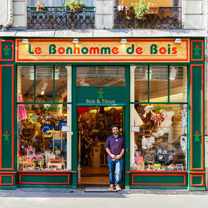 Photograph of the facade and owner of Le Bonhomme de Bois for Paris Re-Tale Project by Sebastian Erras
