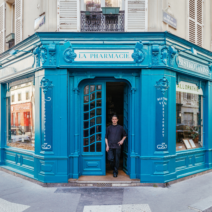A blue pharmacy store front in Paris photographed for the Re-Tale project by Sebastian Erras