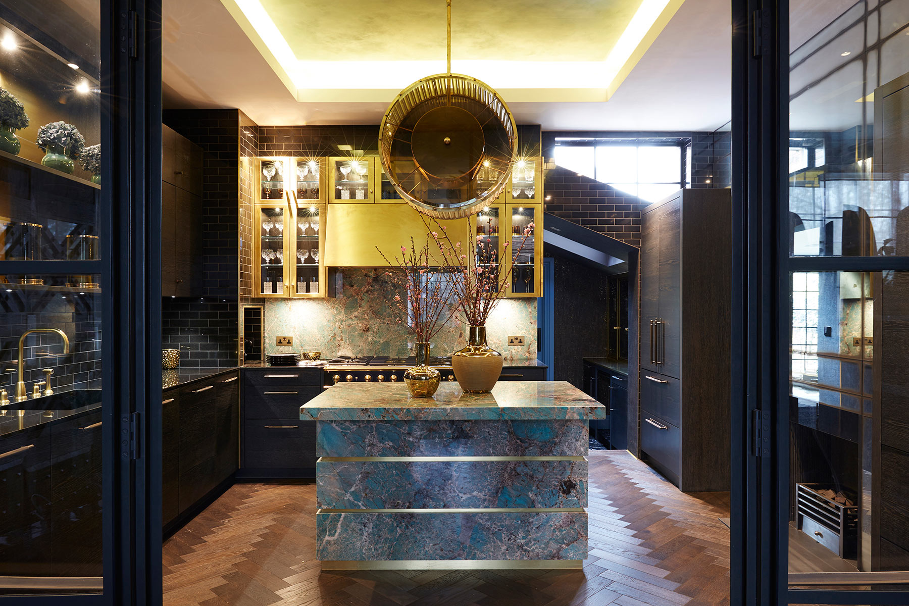 luxury interior Kitchen Design with Tiffany Blue Amazonite Stone Island and Vintage Brass Chandelier by Trilbey Gordon Interiors