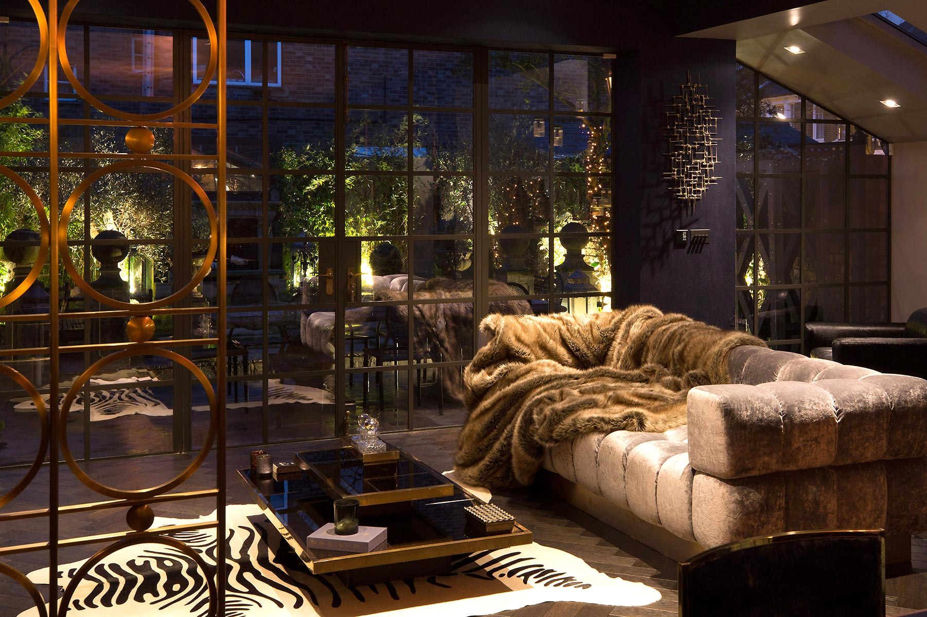 luxury interior sitting room at night in London designed by Trilbey Gordon