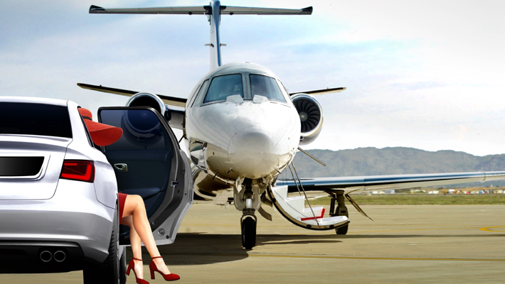 Fashionable Woman exiting a luxury car going to get on a private jet