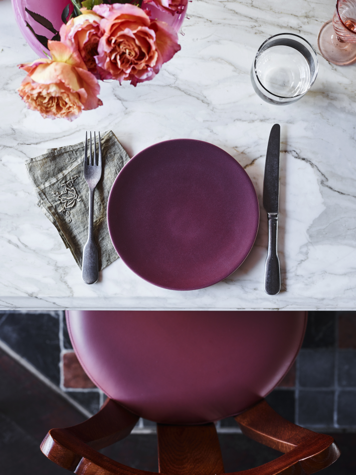 A table setting with purple dishes on a marble table at Pricillas restaurant at the Imperial Hotel Erskineville Sydney Australia - a LGBTQIA+ hotel
