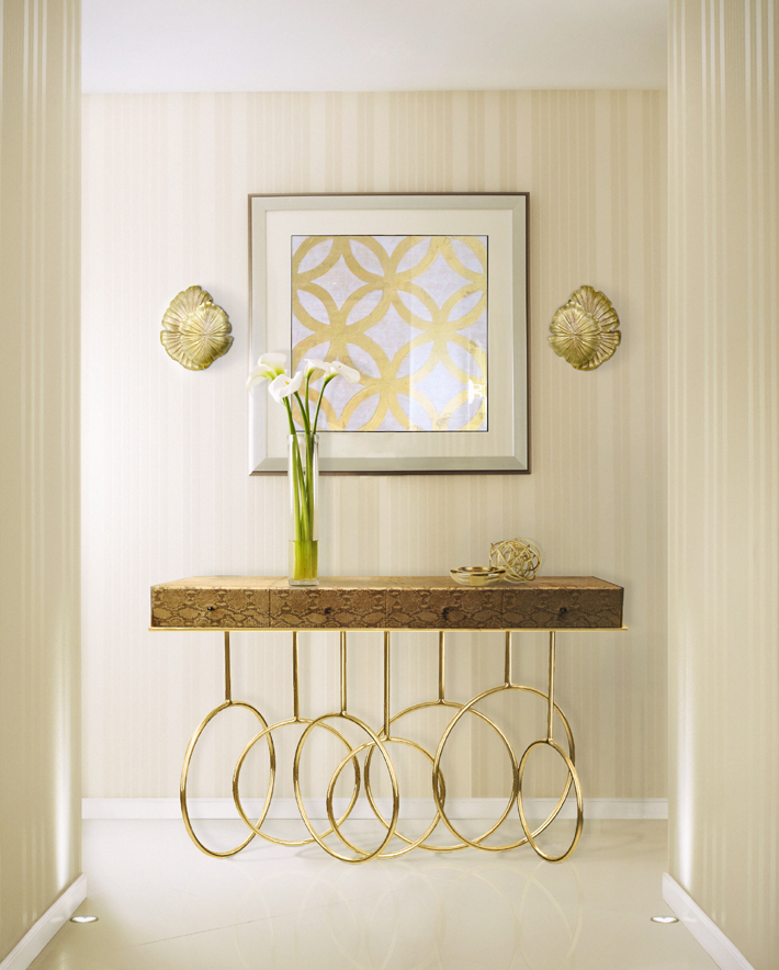 luxury lighting in the foyer - burlesque console table with passion sconces by koket projects