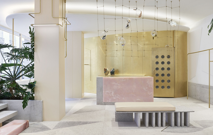 forte forte store paris retail design with pink onyx cash register island, contemporary hanging art, granite and quartz floor and gold leaf wall photo by danilo scarpati