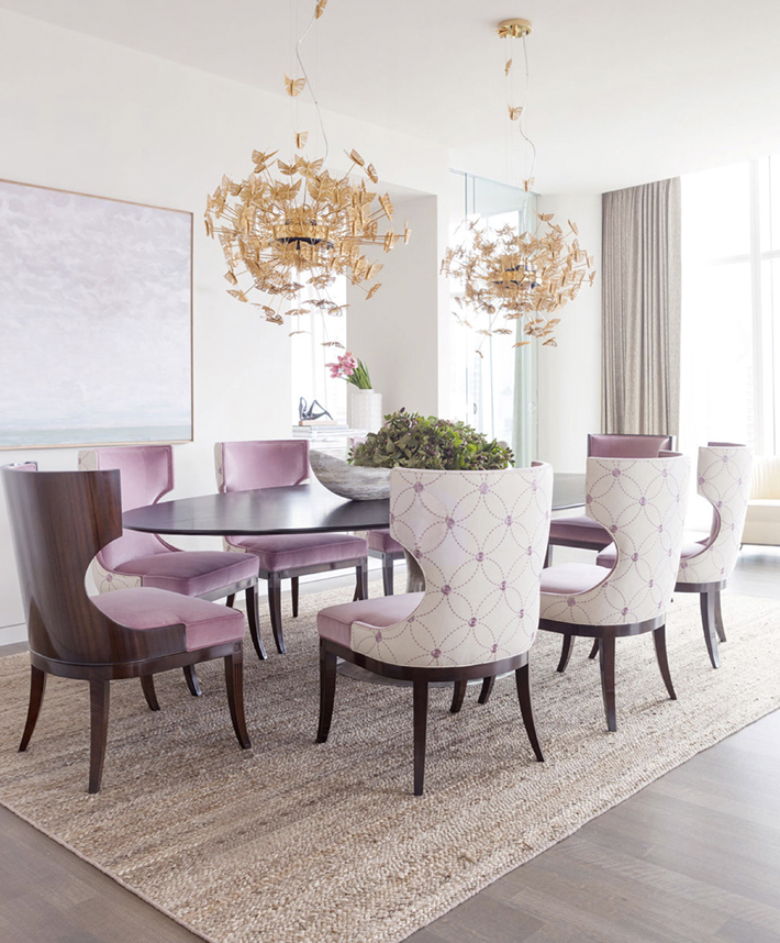 luxury lighting nymph chandelier 1 in a dining room with pink chairs by koket projects