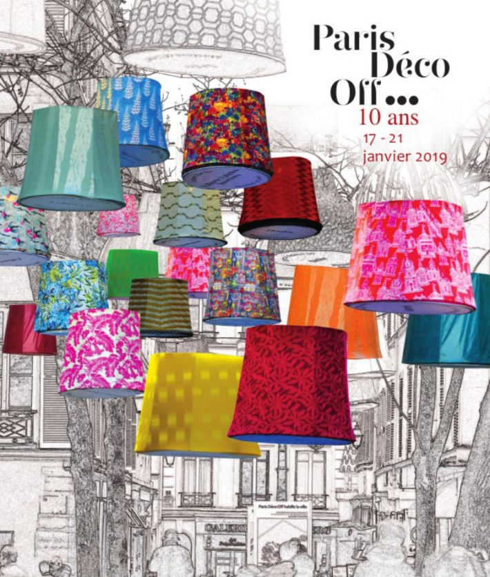Multi-colored Fabric Lampshades hanging in the street between buildings for paris deco off 2019 - interior design events 2019
