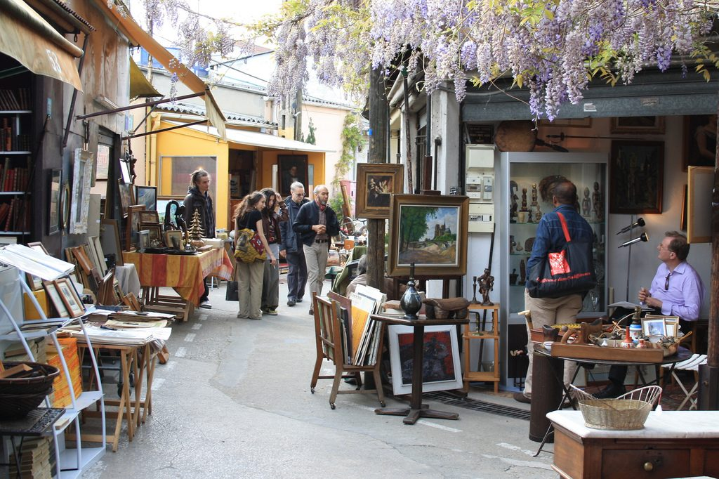 people shopping in the paris flea market - marche aux puces
