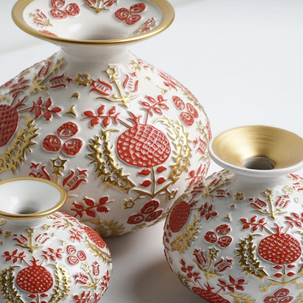Ceramic art by Esma Dereboy - red, gold and white vases with natural motifs