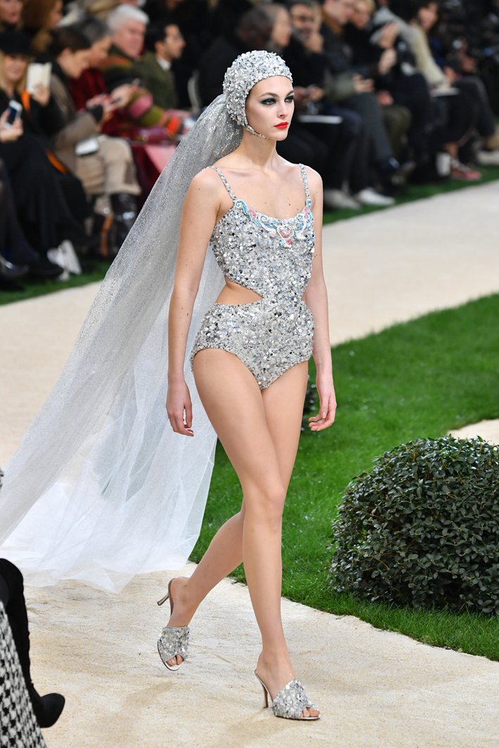A model walks the runway during the Chanel Couture Spring Summer 2019 show in a silver beaded one piece bathing suit with a headdress and veil as part of Paris Fashion Week on January 22, 2019 in Paris, France. Paris Couture (Photo by Pascal Le Segretain/Getty Images)