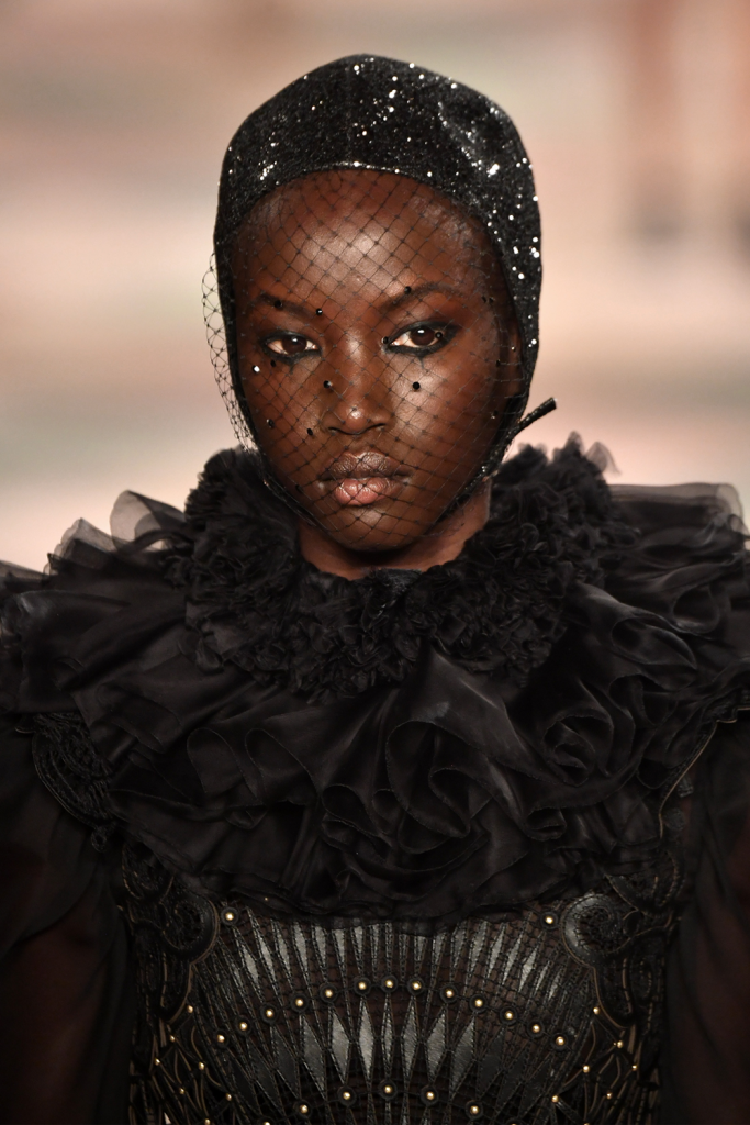 A model walks the runway during the Christian Dior Haute Couture Spring Summer 2019 show in a black dress with leather and tulle accents and a sequin headdress as part of Paris Fashion Week on January 21, 2019 in Paris, France. Paris Couture (Photo by Pascal Le Segretain/Getty Images)