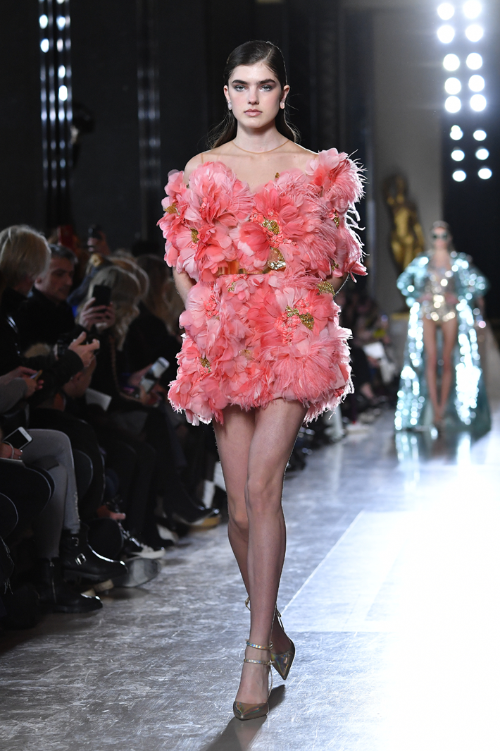 A model walks the runway during the Elie Saab Spring Summer 2019 show in a short coral pink dress covered with faux flowers and feather embellishments as part of Paris Fashion Week on January 23, 2019 in Paris, France. Paris Couture (Photo by Pascal Le Segretain/Getty Images)