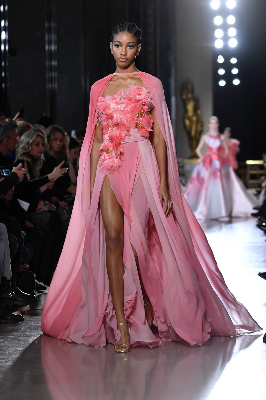 A model walks the runway during the Elie Saab Spring Summer 2019 show in a pink dress with feather and flower embellishments as part of Paris Fashion Week on January 23, 2019 in Paris, France. Paris Couture (Photo by Pascal Le Segretain/Getty Images)