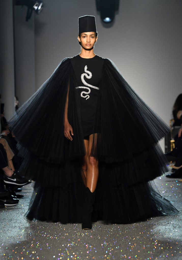 A model walks the runway during the Giambattista Valli Spring Summer 2019 show in a black dress with a silver snake on the front as part of Paris Fashion Week on January 21, 2019 in Paris, France. Paris Couture. (Photo by Pascal Le Segretain/Getty Images)