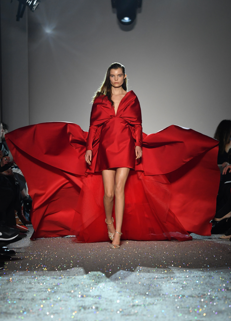 A model walks the runway during the Giambattista Valli Spring Summer 2019 show in a red silk flowing gown as part of Paris Fashion Week on January 21, 2019 in Paris, France. Paris Couture. (Photo by Pascal Le Segretain/Getty Images)