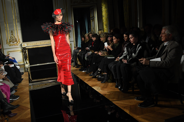 A model walks the runway during the Giorgio Armani Prive Couture Spring Summer 2019 show in a red dress with a black tulle neck as part of Paris Fashion Week on January 22, 2019 in Paris, France.  Paris couture. (Photo by Pascal Le Segretain/Getty Images)