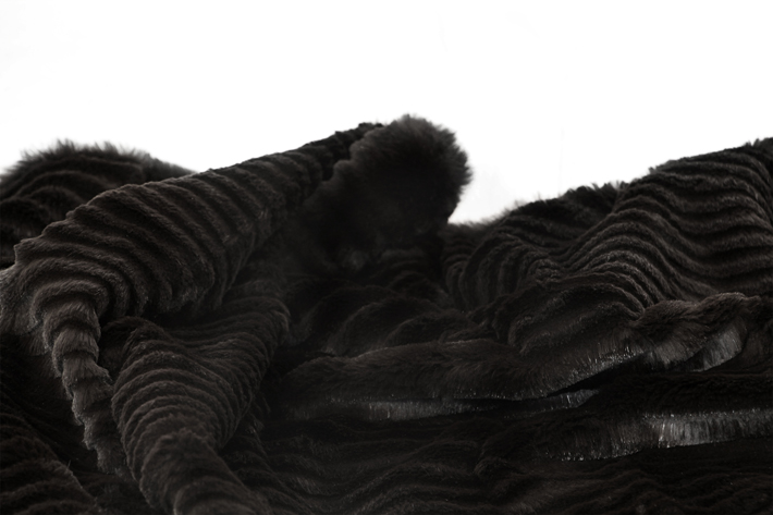 laser cut rabbit black throw by koket - top new year's resolutions