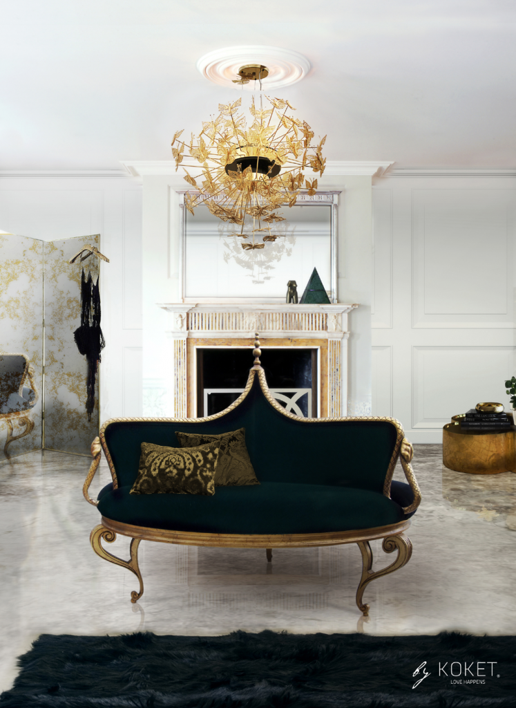 A glamorous living room with a round black banquette accented by gold snakes, an antiqued mirror floor screen and a gold butterfly chandelier - Mistress Banquette, Jezebel Screen & Nymph Chandelier by koket - maison et objet 2019