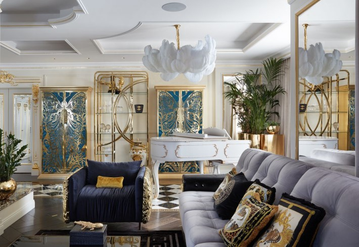luxury interior of gia eradze designed by tatyana mironova featuring the magemoiselle armoire by koket, gold chair by boca do lobo and a white feature chandelier by a grand modern tour