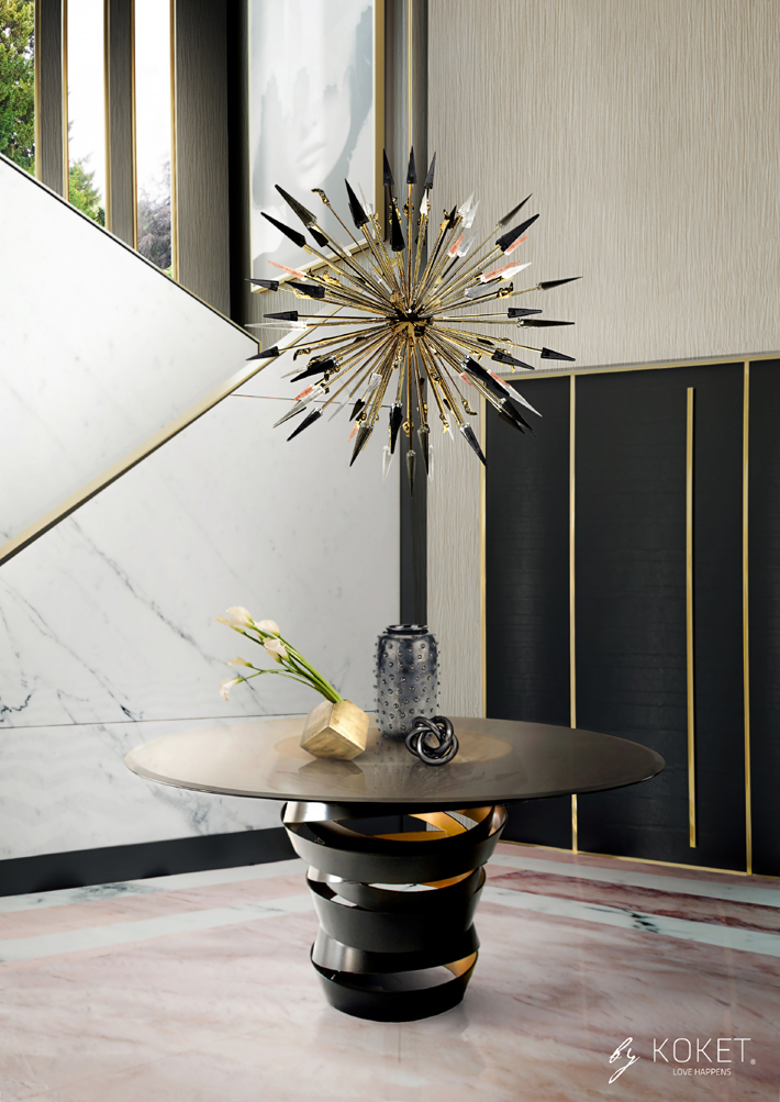 luxurious foyer with black and gold intuition table and outburst chandelier by koket - top new year's resolutions