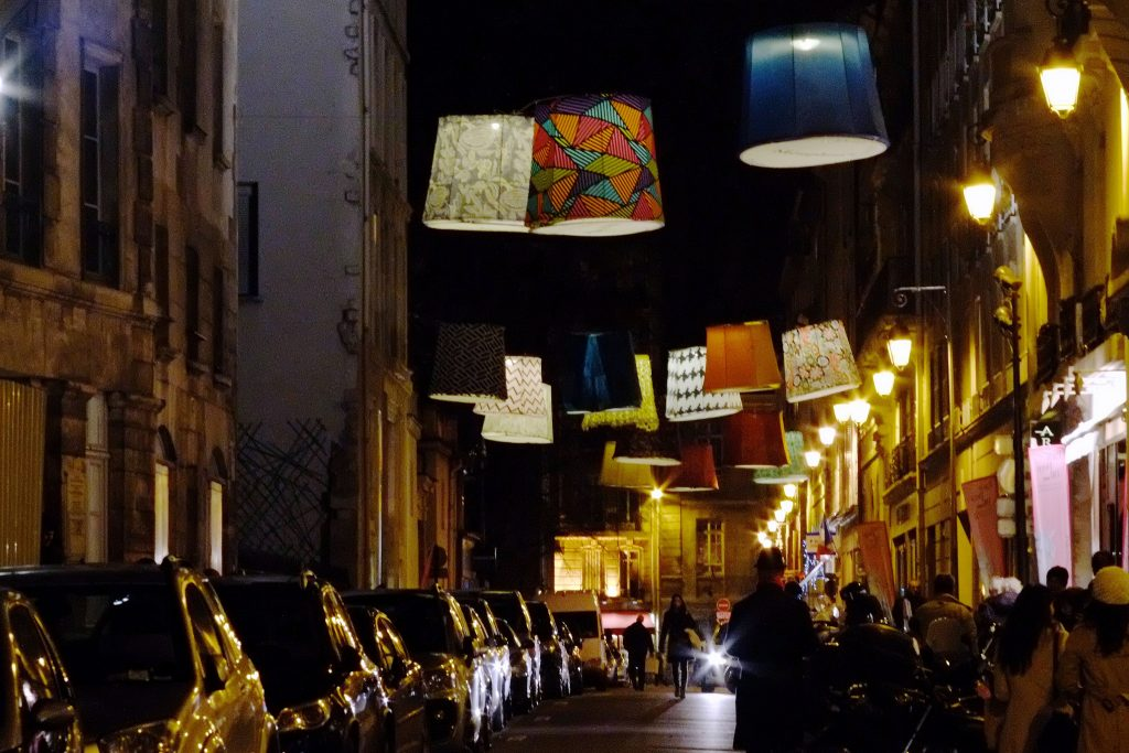 paris deco off - fabric lampshades hanging on rue de l'abbaye - photo by max sat via flickr
