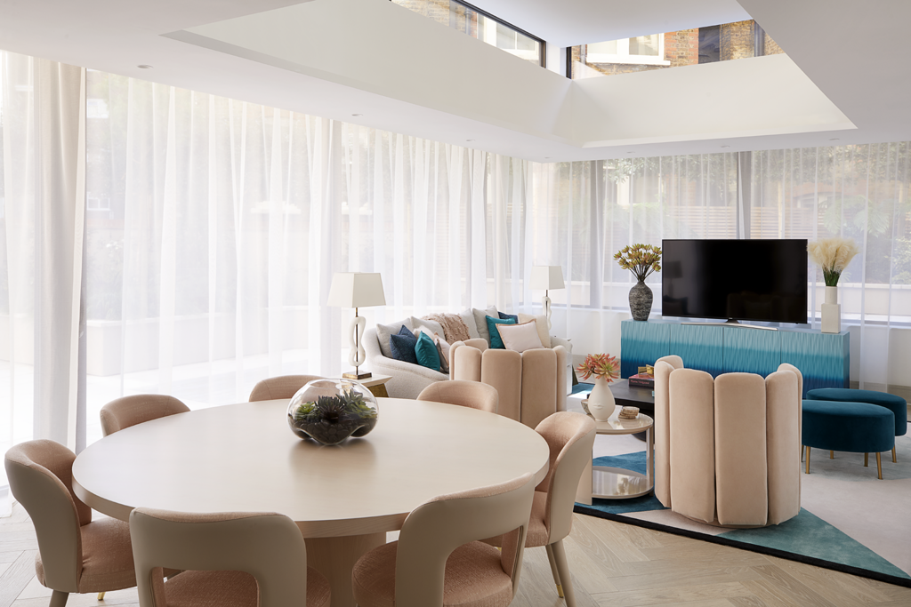 The dining room and living room of a Playful Interior by Elycion