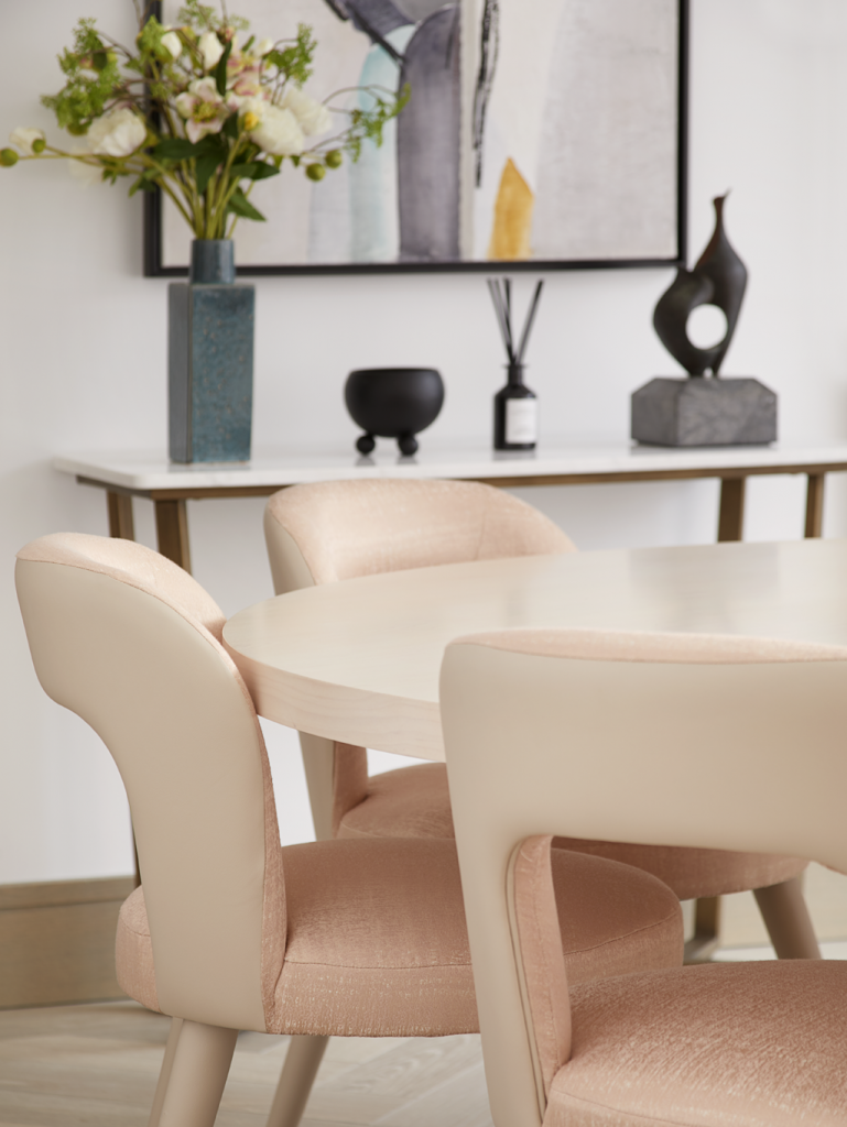 light pink dining chairs in a Playful Interior by Elycion
