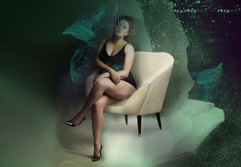 a beautiful woman sitting in one of koket's sexy chairs - the audrey chair by koket