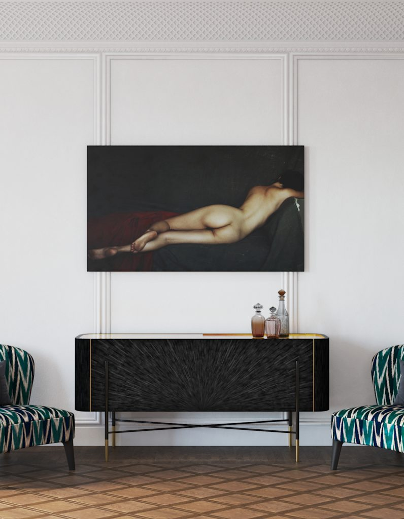 black and gold sideboard flanked by two chairs with a photograph of a nude woman's back above it in an interior by valdim maltsev